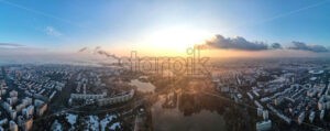 Panorama of Bucharest from a drone, districts of residential buildings with park and lakes, fog other the ground, Romania - Starpik Stock