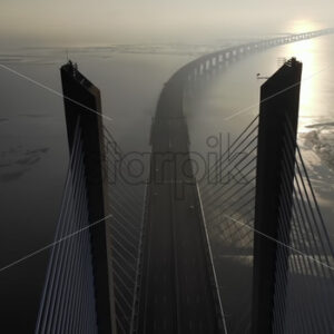 VIDEO – Aerial drone view of Vasco da Gama bridge in Lisbon, Portugal - Starpik Stock