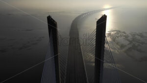 VIDEO – Aerial drone view of Vasco da Gama bridge in Lisbon, Portugal, stock video - Starpik Stock