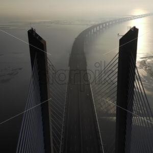 VIDEO – Aerial drone view of Vasco da Gama bridge in Lisbon, Portugal, stock video - Starpik Stock