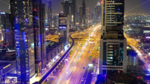 VIDEO – Aerial time lapse shot of moving traffic at night in the center of Dubai city, stock video - Starpik Stock