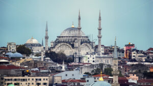 View of Nuruosmaniye Mosque with multiple residential buildings around it, cloudy weather in Istanbul, Turkey - Starpik Stock