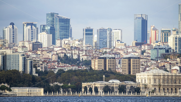 View of a district with residential and high modern buildings in Istanbul, Bosphorus Strait on the foreground, Turkey - Starpik Stock