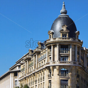 View on silver corner building wall with blue sky, paris city, france - Starpik Stock