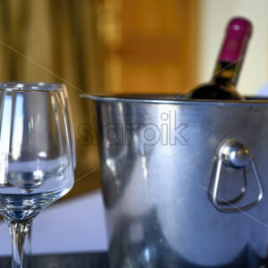 WIne bottle with glasses in a hotel room - Starpik Stock