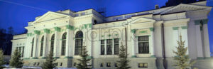 Panorama of Organ Hall building over blue sky at night in Chisinau, Moldova - Starpik Stock