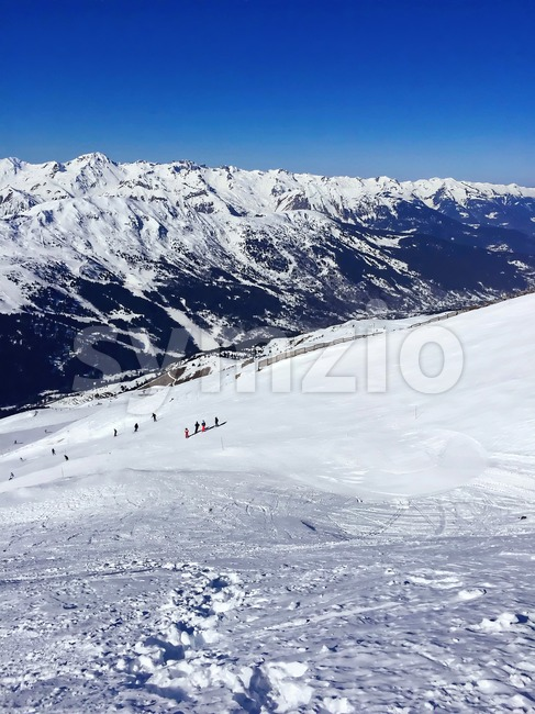 ski slopes in france alps mountains beautiful courchevel in white snow, vertical Stock Photo