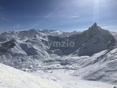 ski slopes in france alps mountains beautiful courchevel in white snow Stock Photo