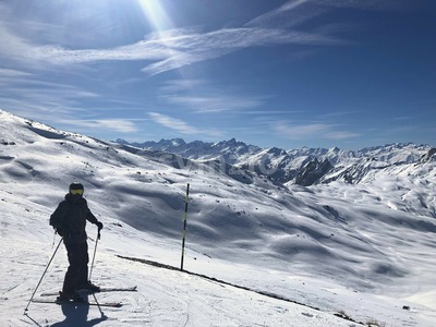 ski slopes in france alps mountains beautiful courchevel in white snow and man in black suite Stock Photo