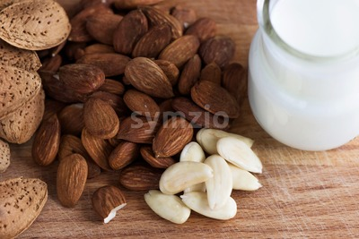 Almond nuts with white milk macro close up composition Stock Photo