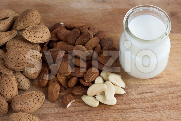Almond nuts with white milk macro close up composition