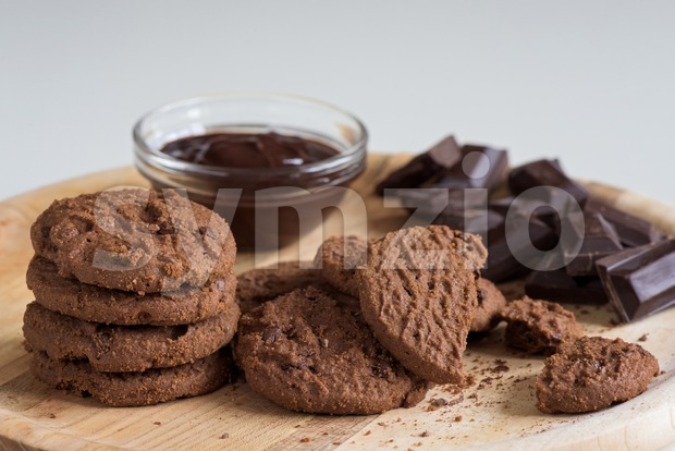 Brown biscuits with dark chocolate composition on a table Stock Photo