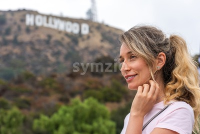 Happy blonde woman at the hollywood mountain in Los Angeles, California Stock Photo