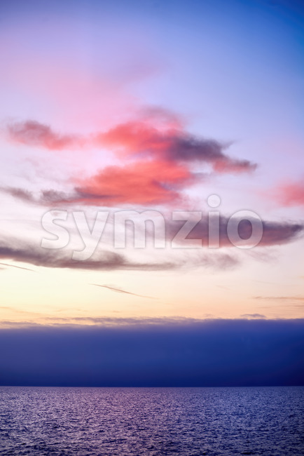 Pacific ocean and sky with blue - orange clouds at sunset in Los Angeles, USA Stock Photo