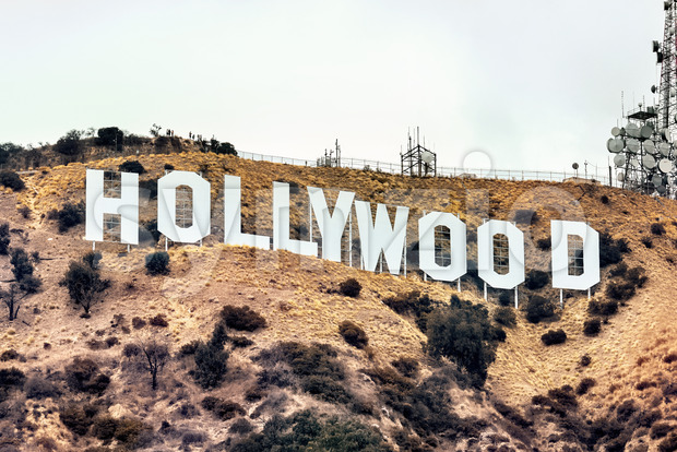 LOS ANGELES, USA - SEPTEMBER 26, 2019: Hollywood sign with communications facility on the hill Stock Photo