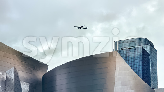 LOS ANGELES, USA - SEPTEMBER 26, 2019: High and modern buildings in downtown, flying plane in the distance Stock Photo