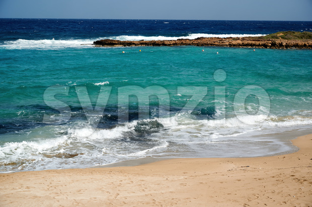Beach and blue, clear water of Mediterranean sea in Ayia Napa Stock Photo