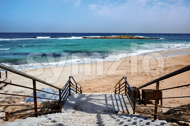 Stairs leading to the beach and blue, clear water in Ayia Napa Stock Photo