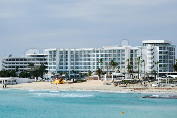 AYIA NAPA, CYPRUS - FEBRUARY 18, 2020: Vassos Nissi Plage Hotel with beach and blue water in front of it Stock Photo