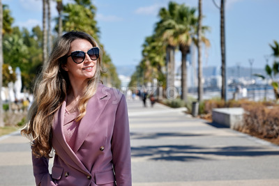Portrait of a caucasian woman in sunglasses on embankment street in Limassol, Cyprus Stock Photo