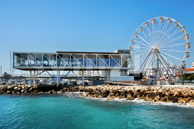 LIMASSOL, CYPRUS - FEBRUARY 17, 2020: Pier One cafe and Ferris ring located near the coastline Stock Photo