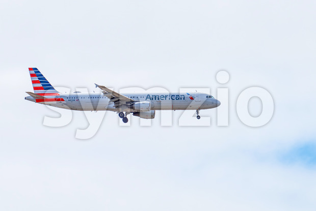 SAN DIEGO, USA - SEPTEMBER 28, 2019: A taking off plane with cloudy sky on the background