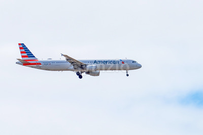 SAN DIEGO, USA - SEPTEMBER 28, 2019: A taking off plane with cloudy sky on the background Stock Photo