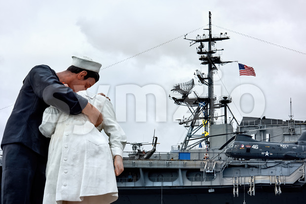 SAN DIEGO, USA - SEPTEMBER 28, 2019: The Kissing Sailor Statue with military helicopters on the background Stock Photo