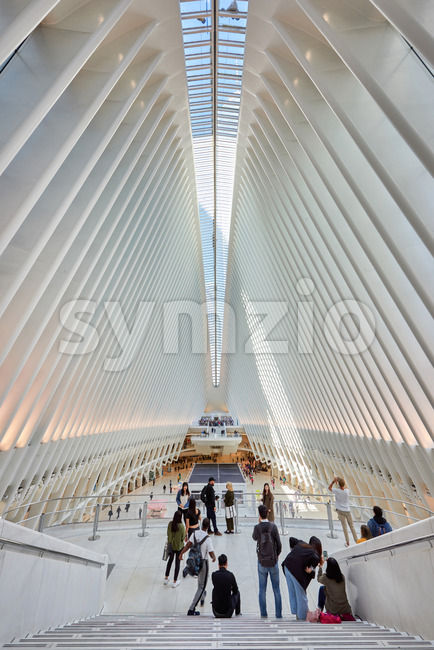 NEW YORK, USA, SEPTEMBER 19: Vertical shot of incredible World Trade Center Station's interior space with lots of busy and relaxing people Stock Photo