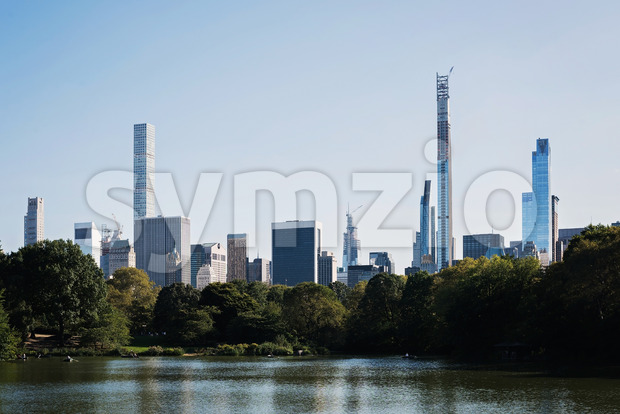 Color DSLR landscape picture of Turtle Pond in Central Park, beautiful panorama of the New York City, USA