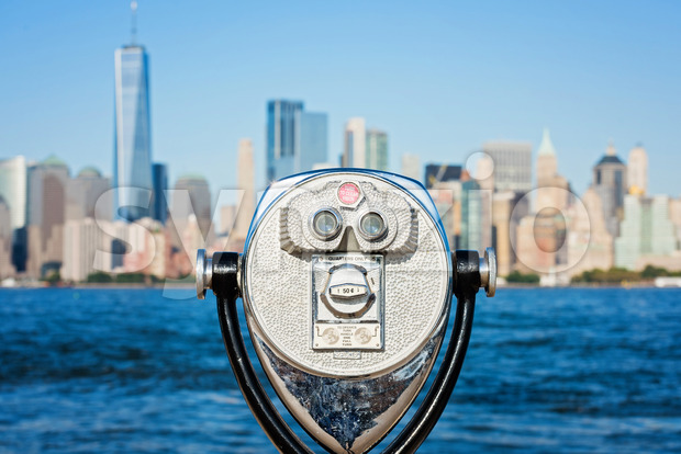 Vintage touristic binocular on the panorama of New York City during the day, USA