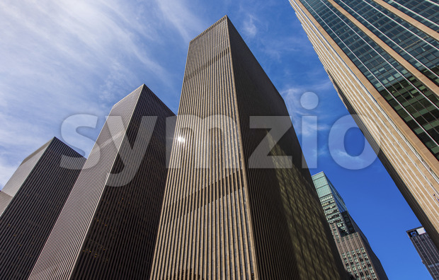 a beautiful shoot of a three similar modern buildings arranged next to each other in the New York city, USA Stock Photo