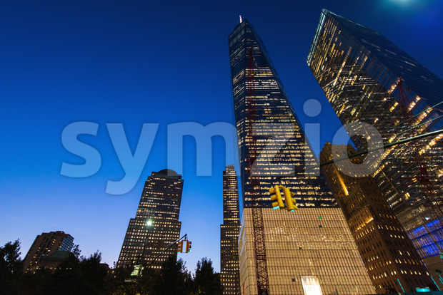 New York City at night, tall buildings with lights, Manhattan, USA Stock Photo