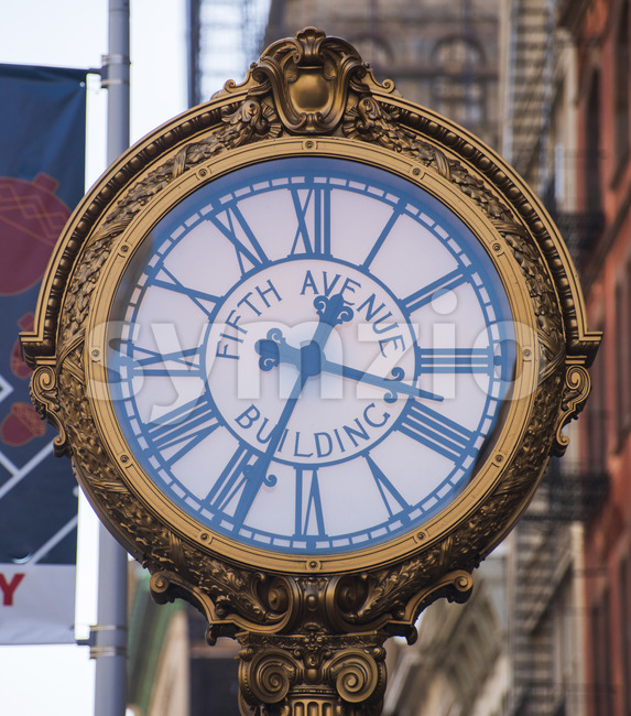 old clock on the fifth avenue street in the New York city, USA Stock Photo