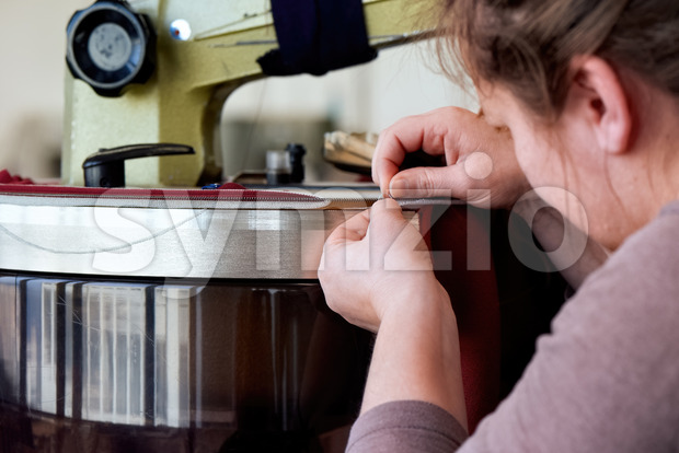 Seamstress at the work with fabric Stock Photo