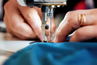 Woman working on a sewing machine Stock Photo