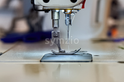 Sewing machine and white thread Stock Photo