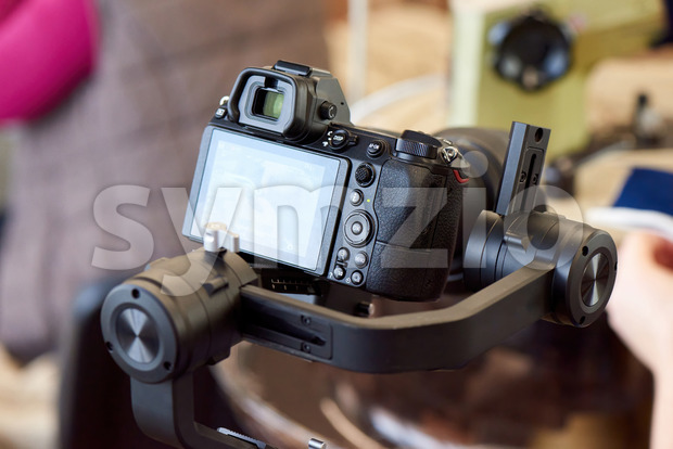Mirrorless camera on gimbal stabilizer Stock Photo
