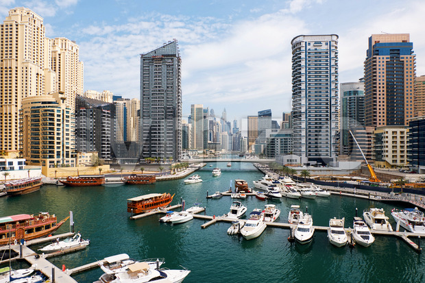 Dubai marina cityscape at daylight. Clear sky. United Arab Emirates. Yachts parked in port. Stock Photo