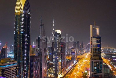 Dubai night cityscape with highway and ligths. United Arab Emirates Stock Photo