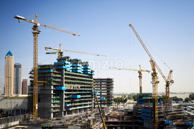 Construction site with cranes and people working. Dubai, United Arab Emirates Stock Photo