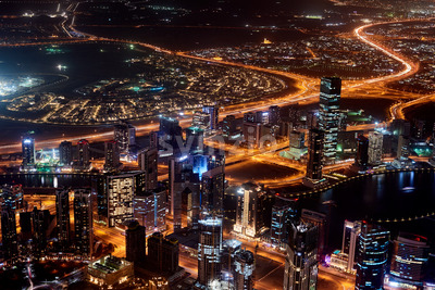 Dubai Cityscape at sunset blue hour from tallest building view. United Arab Emirates Stock Photo