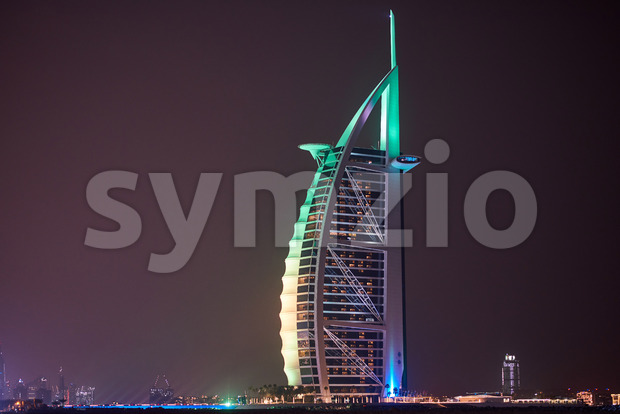 DUBAI, UNITED ARAB EMIRATES - FEBRUARY 23, 2019: Burj Al Arab with colorful lights at night Stock Photo