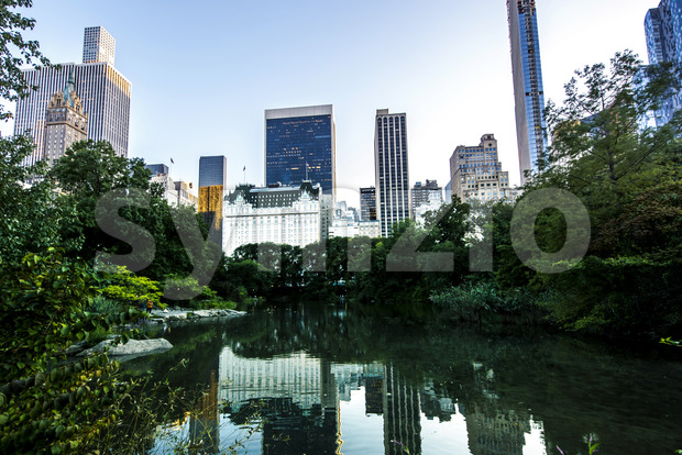 Lake in Central Park with skyscrapers on the background in New York, USA. Vibrant colors Stock Photo