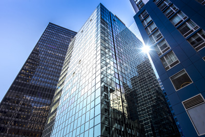 Modern building with glass facade in New York, USA. Vibrant colors Stock Photo