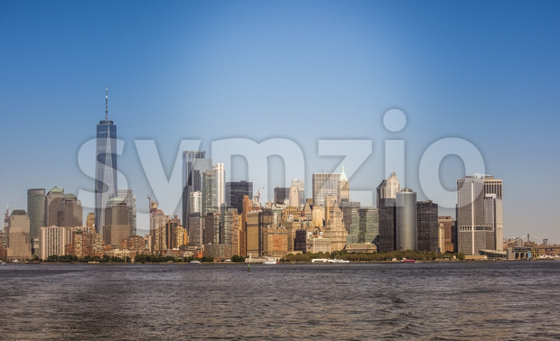 View of Manhattan from the water, multiple high buildings in New York, USA. Vibrant colors