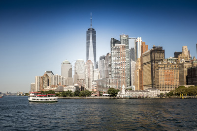 View of Manhattan from the water, cruise ship on the foreground, multiple high buildings in New York, USA. Vibrant colors Stock Photo