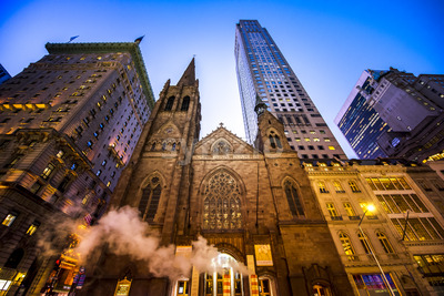 NEW YORK, USA - SEPTEMBER 19, 2019: Fifth Avenue Presbyterian Church and skyscrapers at night. Vibrant colors Stock Photo