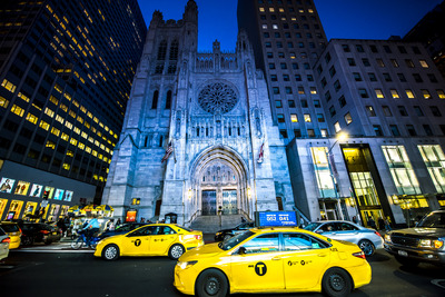 NEW YORK, USA - SEPTEMBER 19, 2019: Saint Thomas Church at night with cars on the foreground. Vibrant colors Stock Photo