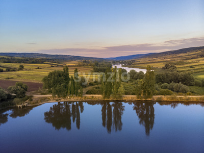 Nature with lake and hills in Moldova near Balanesti village, trees reflection Stock Photo
